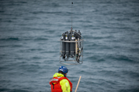 The frame holding CTD sensors and water sampling bottles is being recovered from the ocean after sampling.: Photo: Espen Storheim
