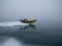 Students on small boat to conduct acoustic experiments far from KV Svalbard.: Photo: Espen Storheim, NERSC