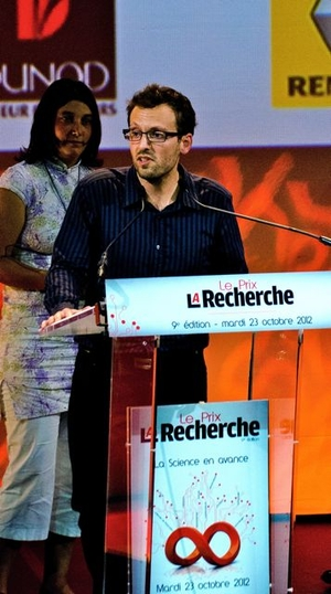 "Dr. Pierre Rampal receives the ""le Prix de La Recherche""  in Paris."