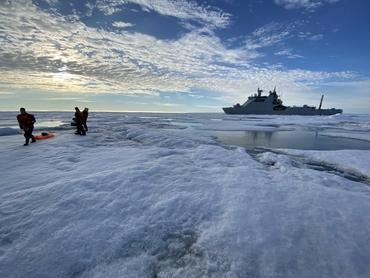CAATEX 2020 research cruise: Researchers on sea ice in front of KV Svalbard in the Arctic Ocean. Credit: Andreas Kjøl, Norwegian Coastal Administration.