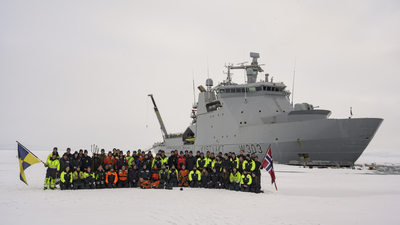 Photo: The entire crew and scientists at KV Svalbard during the CAATEX cruise at the North Pole. Credit: Norwegian Coast Guard.
