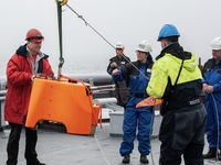 Deploying an OBS in the Fram Strait: Jürgen Gossler (left), Zeinab Jeddi (center) and Franck Andersen (right).