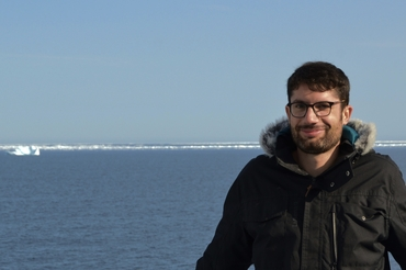 First author Guillaume Boutin onboard the research vessel Pourquoi Pas? in the Arctic in August 2017 with the sea ice edge in the background