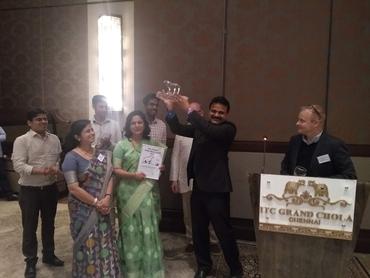 Director Sebastian Mernild handing the Nansen Polar Bear Award for 2019 to Executive director Ajith Joseph and deputy director Nandini Menon from NERCI at ICT Grand Choal in Chennai.