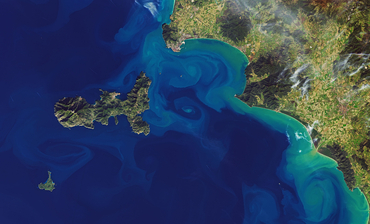 Example of eddies in the Mediterranean off the Italian coast.: Natural-colour satellite image by Landsat 8. Sediments are transported by eddies and create the swirl patterns typical for these. Source: NASA Earth Observatory, https://earthobservatory.nasa.gov/images/146231/eddy-extravaganza-off-th...