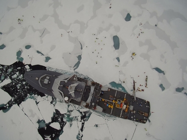 Drone photo: KV Svalbard and the CAATEX ice station taken at the North Pole. Credit: NORCE.